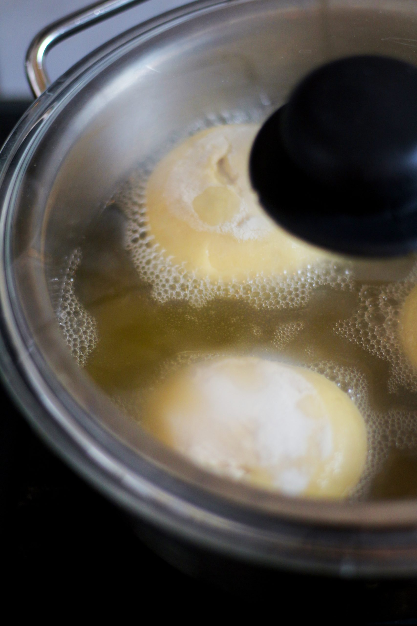 Krapfen cooking in oil